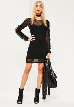 Czarna dopasowana sukienka z dodatkiem siatki z ozdobnymi falbankami na rękawach
