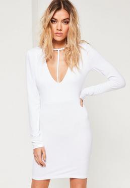Robe moulante blanche harnais à manches longues