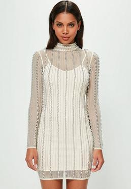 Peace + Love Beżowa dopasowana sukienka z golfem w paski z koralików