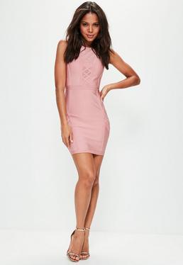 Różowa bandażowa dopasowana sukienka ze wstawkami z siatki