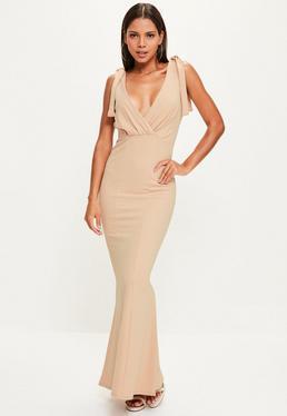 Beżowa długa sukienka wiązana na ramionach z głębokim dekoltem