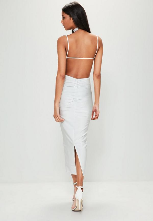 Lulus Exclusive! When you slip into the Lulus So Stunning White Backless Midi Dress you will be just that, so stunning! Figure-flaunting stretch knit frames your curves from a high, rounded neckline and sleeveless, darted bodice, down to a midi-length hem/5(16).
