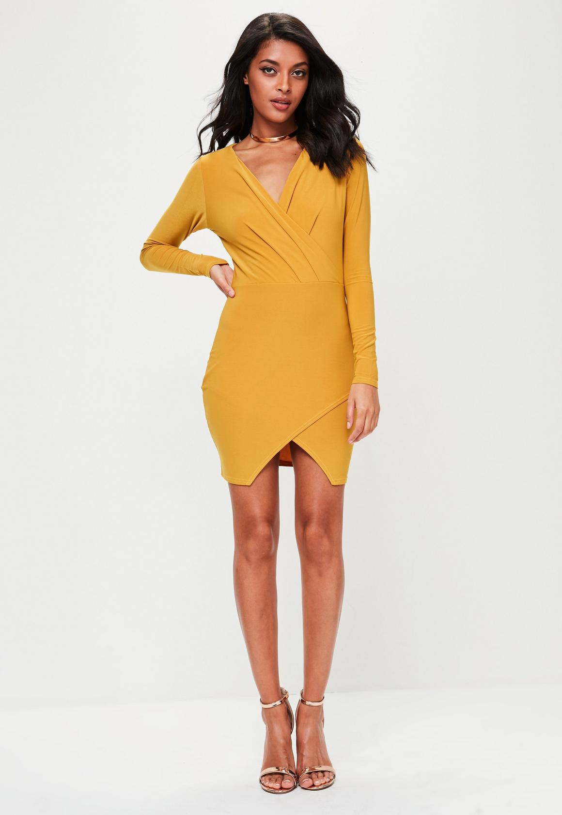 Yellow long sleeve bodycon dress.