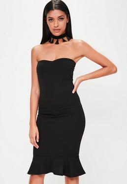 Czarna sukienka midi z falbaną