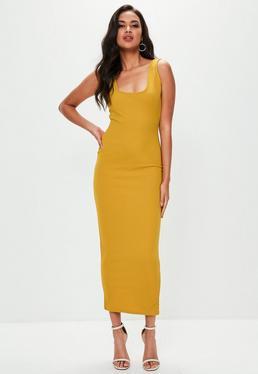 Żółta dopasowana sukienka maxi