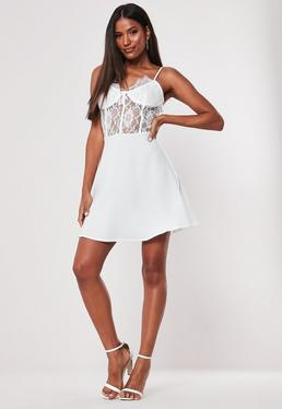 aa9f6f3d8a6d White One Shoulder Drape Playsuit · White Lace Bust Cup Skater Dress