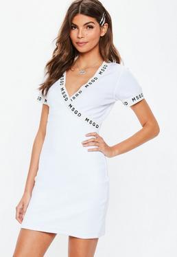 fc32a06aac9 Vestido blazer con cinturón de crepé en blanco · Vestido corto cruzado con  ribete MSGD en blanco