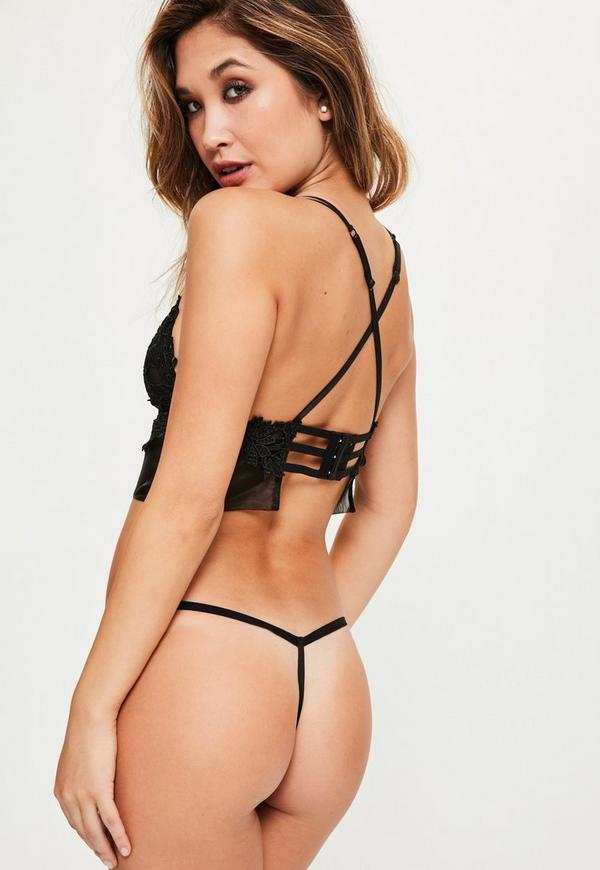 Strappy Lace Triangle Bra Black. Strappy Lace Triangle Bra Black $ Previous Next. Shop This Look Ready to get your hands on some of the hottest lingerie in town?! We're lusting over this romantic-femme bra engineered with edgy cross-front straps. This beaut is a must have for updating your sexy lingerie collection and in a fierce black Brand: Missguided.
