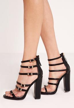 Sandales noires à talon carré et boucles dorées