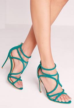 Sandales vertes à talon et lanières croisées