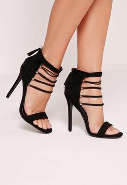 Zarte Sandalen mit elastischen Riemchen und Absatz in Schwarz