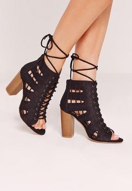 Sandales noires à talon marron détail lacets