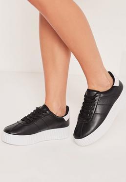 Zapatillas de plataforma plana con suela blanca negras