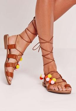 Pom Pom Lace Up flat Sandals Tan