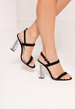 Sandales noires brillantes à talons transparents