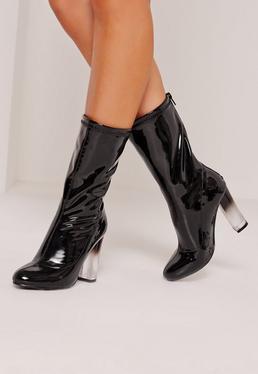 Ankle Boots in Lackoptik mit transparentem Absatz in Schwarz
