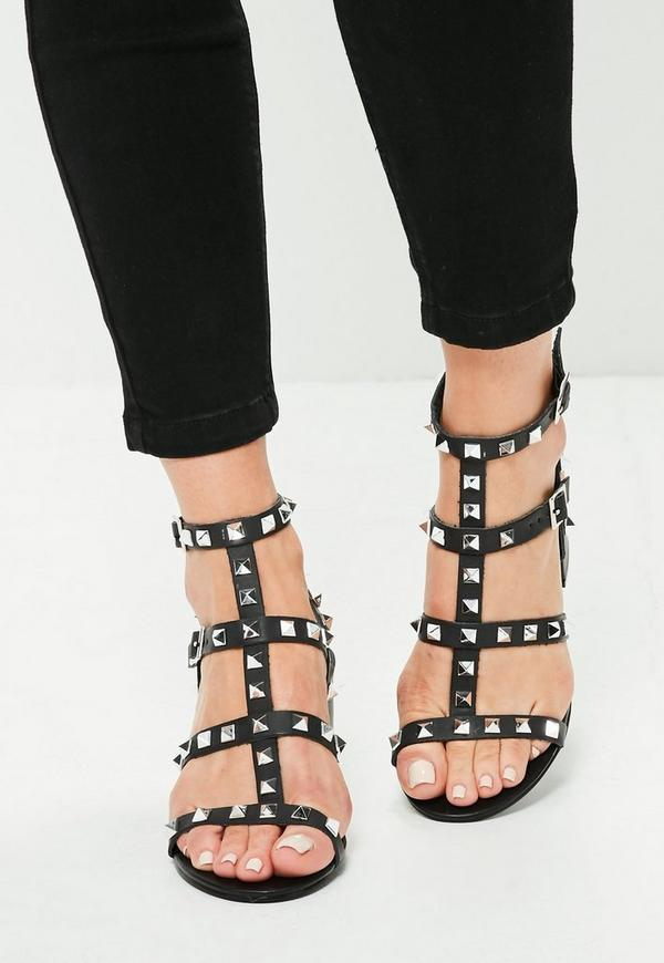 Put your most stylish foot forward in the Lulus Mckenzie Black Studded Slide Sandals! These vegan leather sandals feature a caged silhouette atop a peep-toe upper. Black studs across the slender straps add a fashion forward twist to these cute slides/5(19).
