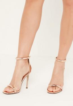 Sandalias de tacón fino con tiras en oro rosa