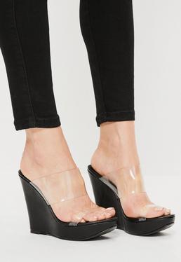 Schwarze Wedge Sandalen mit transparenten Riemen