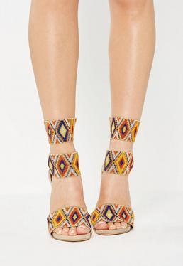Beżowe sandały na szpilce z gitarowymi paskami