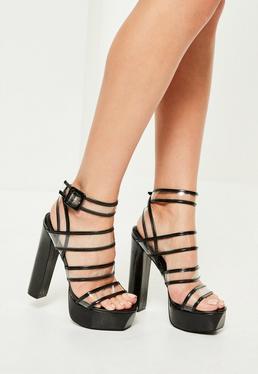 Czarne buty na wysokiej platformie z przezroczystymi wstawkami