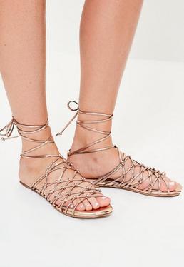 Sandales spartiates roses dorées avec nœuds