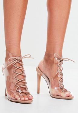 Sandalias de tacón con entrelazado y frontal transparente en nude