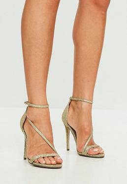 Sandalias de tacón fino brillantes en dorado
