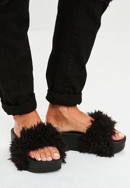 Schwarze Flatform Sandalen mit Fell