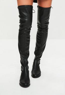 Botas hasta el muslo planas de cuero sintético en negro