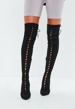 Botas entrelazadas hasta la rodilla en negro