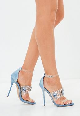 Sandalias de tacón fino con tira transparente de pedrería en azul