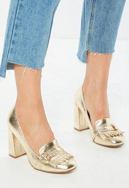 Złote buty na obcasie z ćwiekami