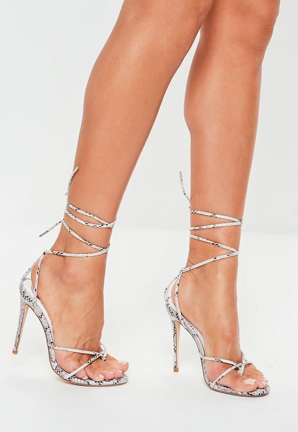 d5a8b2d87b3 ... White Snake Thong Skinny Ankle Tie Heels. Previous Next