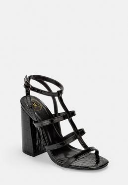 Расклешенные босоножки на каблуке из черного крокодила