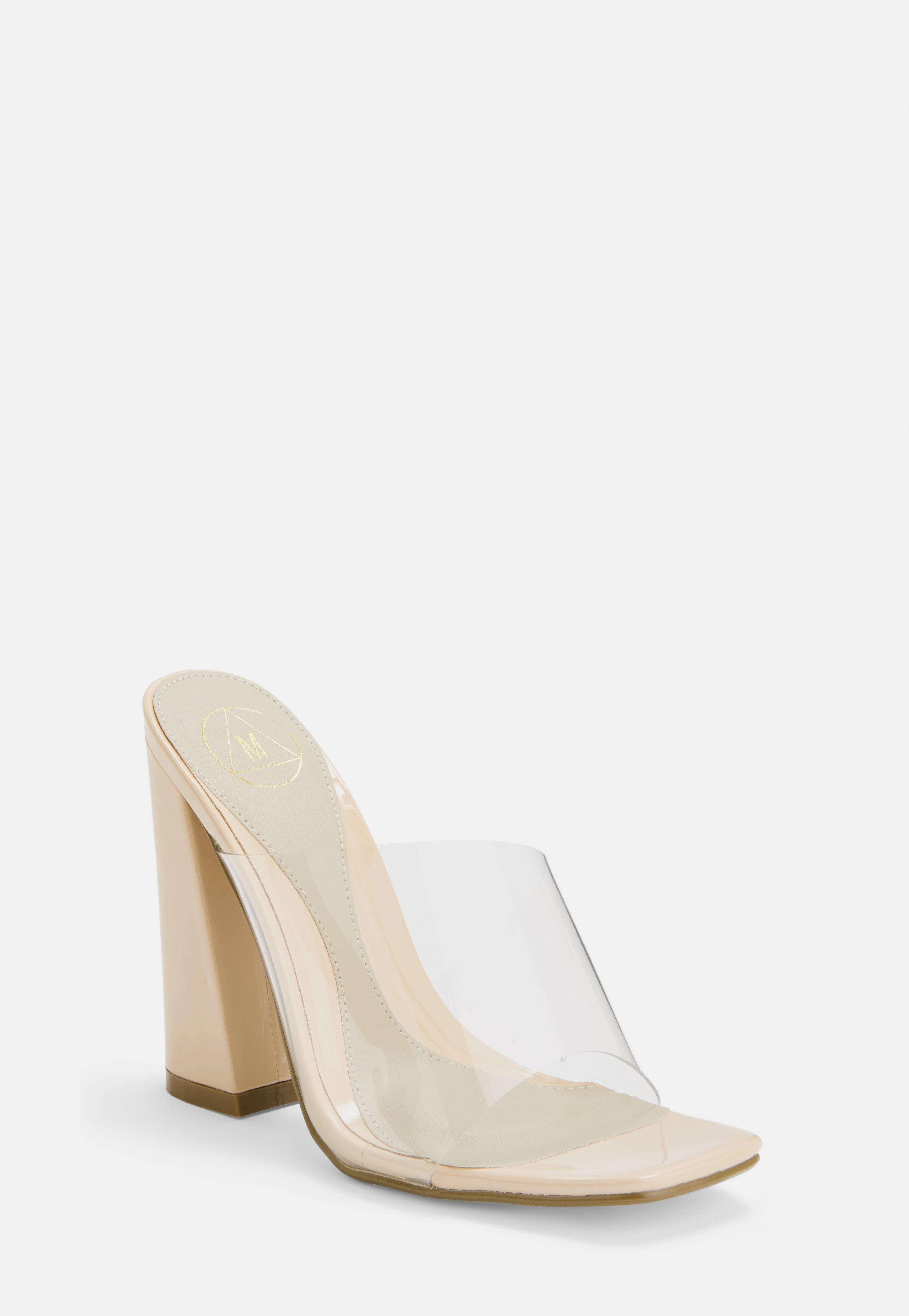 3e169025b1 Nude Asymmetric Clear Flared Heel Mules