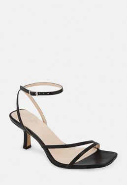 Черные босоножки на низком каблуке