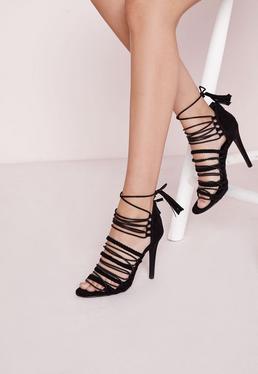 Sandales noires à talon et lanières tressées