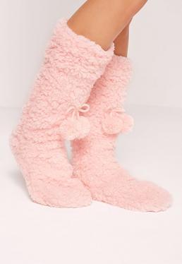 Chaussons-chaussettes roses à pompons