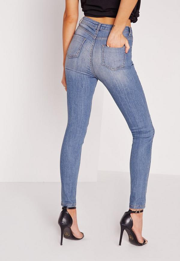 Get your denim fix with a pair of classic skinny jeans. This figure flattering shape works a 90's edge into the mix with ripped details for a fierce daytime look, or super soft .
