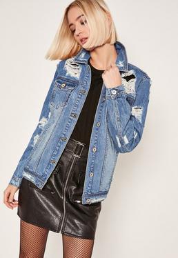 Niebieska podarta kurtka jeansowa
