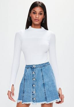Mini-jupe en jean bleue bords déchirés