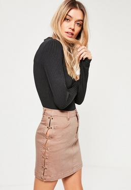 Mini-jupe en jean nude détails lanières