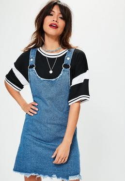 Niebieska jeansowa sukienka na szelkach