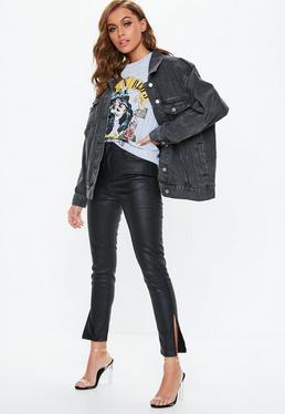 Czarne dopasowane jeansy z rozciętymi nogawkami i wysokim stanem