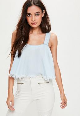 Niebieski krótki poszarpany jeansowy top