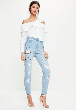 Riot Blaue Jeans mit Rosen-Blatt Grafik