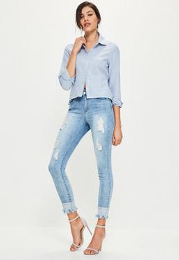Niebieskie poszarpane spodnie jeansowe Anarchy ze średnim stanem