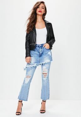 Niebieskie podarte jeansy ze średnim stanem i spódniczką