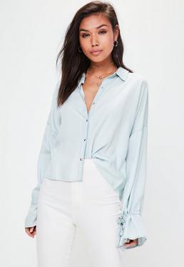 Camisa vaquera con lazos en las mangas en azul
